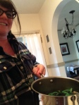 Just a girl and her pot of dyed green hot dogs